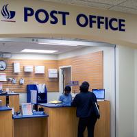 Giải bài tập SGK Tiếng Anh lớp 11 Unit 9: The Post Office