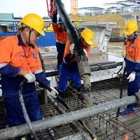 Văn mẫu lớp 5: Tả chú công nhân đang xây nhà